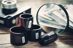Photo film rolls, retro camera, photos and magnifier Royalty Free Stock Photo