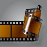 Photo film strip. Curled photo film strip on gray background. Movies concept. Contain the Clipping Path. There is in addition a vector format (EPS 10 Royalty Free Stock Images