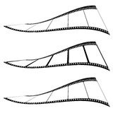 Photo film strip twist. Three pieces of film with variations twisted and with blank photo frame Stock Photo