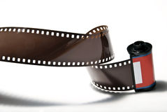 Photo film V1. A rolled out analogous photo film on white background Stock Image