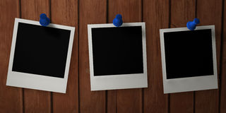 Photo films pinned on wooden board Royalty Free Stock Photography