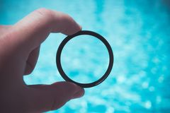 Photo filter in the man`s hands near the pool close-up stock image