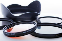 Photo filters and lens hood. On white background Stock Images