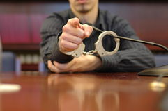 Photo finger. Trial concept, trial concept, handcuffs and microphone Stock Photography