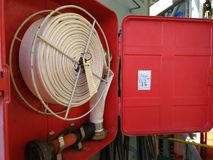 Photo of fire hose reel box on board offshore drilling rig. Emergency preparedness and readiness are one of most important things in oil and gas industry Stock Image