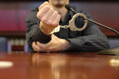 Photo fist. Trial concept, handcuffs and microphone Royalty Free Stock Image