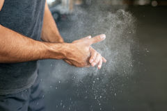 Photo of fitness hands. Rubbing hands with chalk stock image
