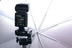 Photo flash and umbrella Stock Images