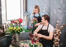 Photo of florists working in pairs. Pleasant company Stock Images
