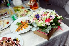 Flowers and food on the table stock images