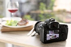 Photo of food for blog on camera screen indoors. Space for text royalty free stock photography