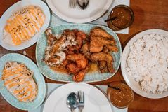 Photo of a food buffet of chicken wings with various flavors, cheesy pasta carbonara with rice, iced tea for commercial purposes. Photo of a food buffet of royalty free stock photo