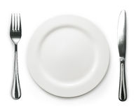 Photo of the fork and knife with white plate on white Royalty Free Stock Photos