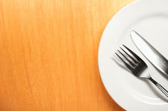 Photo of the fork and knife with white plate on wo Royalty Free Stock Image