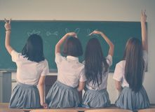 Photo of Four Girls Wearing School Uniform Doing Hand Signs royalty free stock photos