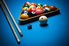 Photo fragment of the blue pool billiard game with cue. Pool bil Stock Images