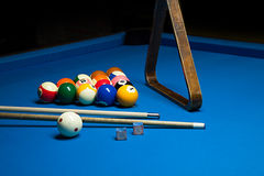 Photo fragment of the blue pool billiard game with cue. Pool bil Stock Photos
