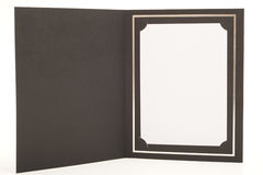 Photo frame. Photograph of a card photoframe with a blanc photo inserted, shot in studio and isolated on a white background Royalty Free Stock Photography