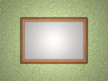 Photo frame. A blank photo frame hanging on wall Stock Photos