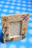 Photo frame. One photo frame on blue background royalty free stock images