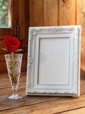 Photo Frame And A Red Rose Royalty Free Stock Photography