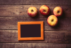 Photo frame and apples Royalty Free Stock Image