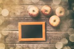 Photo frame and apples Royalty Free Stock Photography