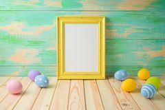 Photo frame or artwork display mock up on wooden table stock photography