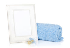 Photo frame with bath towel and boy dummy Royalty Free Stock Images