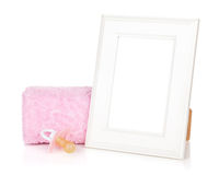 Photo frame with bath towel and girl dummy stock photography