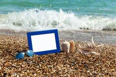 Photo frame on the beach, photography on the beach, sea shells, Royalty Free Stock Photos