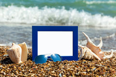 Photo frame on the beach, photography on the beach, sea shells, Royalty Free Stock Photo