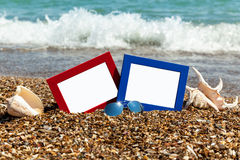 Photo frame on the beach, photography on the beach, sea shells, Royalty Free Stock Photos