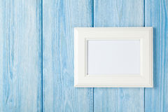 Photo frame on blue wooden wall Stock Photo