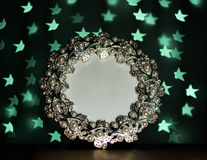 Photo frame with blur green stars on black background Stock Photo