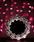 Photo frame with blur red hearts on black background stock image