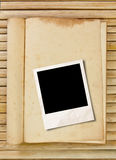 Photo frame with book Stock Photos