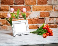 Photo frame with bouquet of tulips Stock Photo