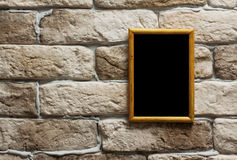 Photo frame on brick wall Royalty Free Stock Image