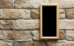 Photo frame on brick wall Stock Images