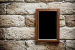 Photo frame on brick wall Royalty Free Stock Photo