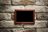 Photo frame on brick wall Royalty Free Stock Images
