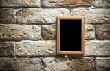 Photo frame on brick wall Royalty Free Stock Photography