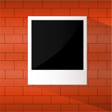 Photo frame on a brick wall Royalty Free Stock Photos