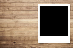 Photo frame on Brown wood plank Royalty Free Stock Photos
