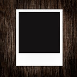 Photo frame on Brown wood plank wall texture Stock Photography