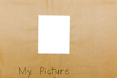 Photo frame child isolated my picture. This old schoolhouse project created by children on yellowed and dry rough paper may be used for pictures, photos or Stock Photos