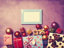 Photo frame and christmas gifts Royalty Free Stock Photography