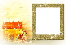 Kids photo frame Christmas greeting card. Photo frame Christmas greeting card. Funny Santa Claus, reindeer and cottage, empty frame to put photo or message Royalty Free Stock Images