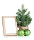 Photo frame, christmas tree and baubles Stock Image